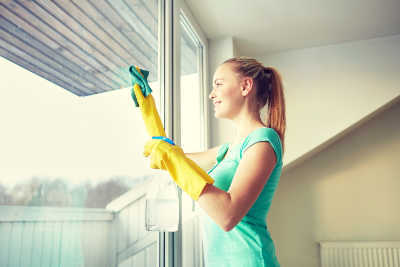 Best commercial window cleaners in Los Angeles - Woman washing her windows in her home.